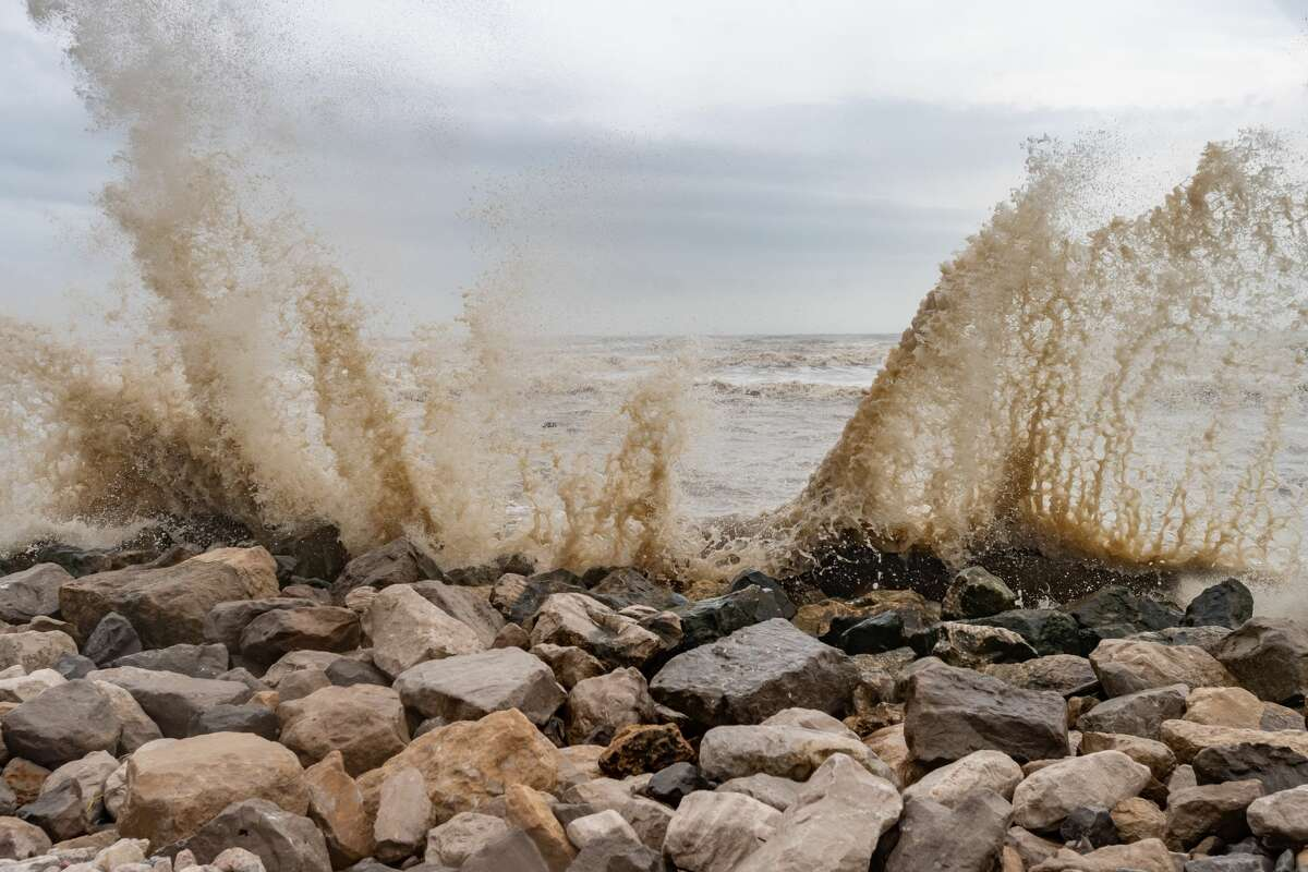 Gulf water comes crashing over the rocks and seawall spilling onto Texas State Highway 87 on Saturday morning. Even though Hurricane Hanna made landfall several hundred miles south of the Bolivar Peninsula, the storm still had an effect on the area. Photo made on July 25, 2020. Fran Ruchalski/The Enterprise