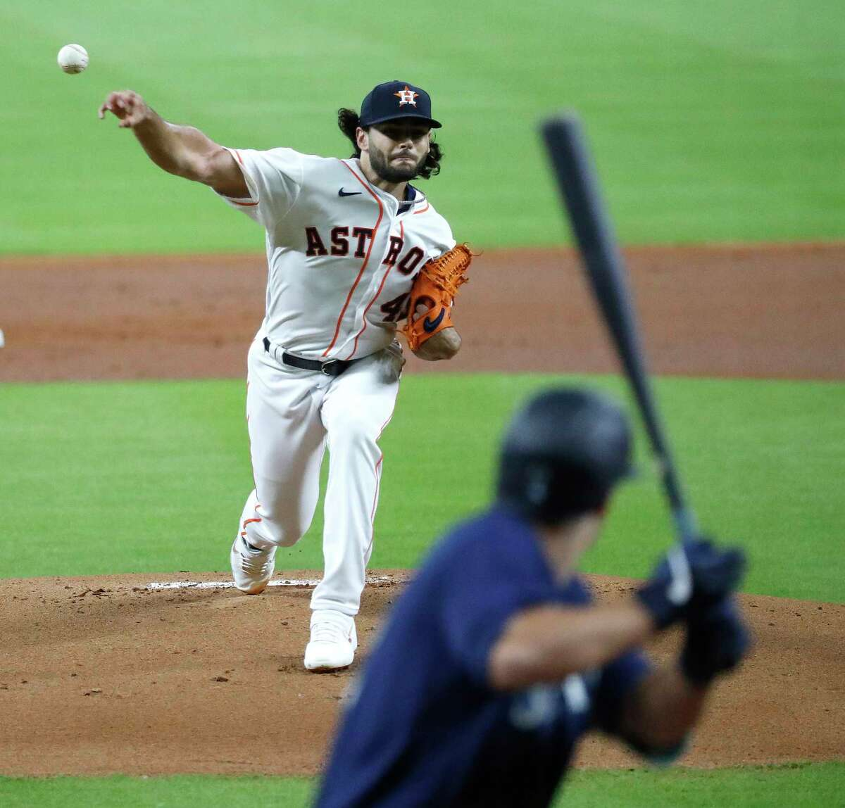 Houston Astros pitcher Lance McCullers Jr. pitches to Seattle Mariners Evan White (12) during the first inning of an MLB baseball game at Minute Maid Park, Saturday, July 25, 2020, in Houston.