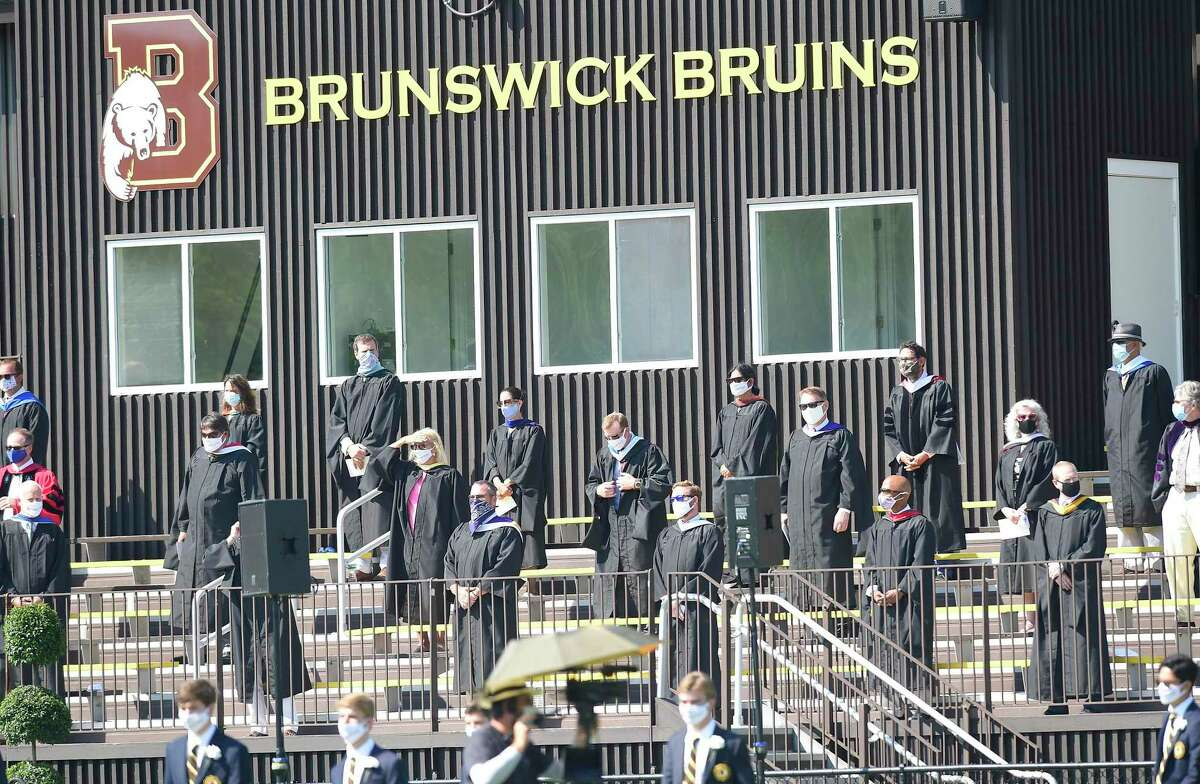 Brunswick School held its One hundred and Eighteenth Commencement ceremony on Cosby Field July 25, 202 in Greenwich, Connecticut. After an invocation by the Rev. Thomas L. Nins, Brunswick Head of School Thomas Philip shared his admiration of the Class of 2020 at the all boys independent school.