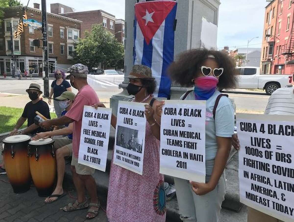 Speakers, signs and congas were featured at Saturday's Black Lives Matter-Support Cuba rally.