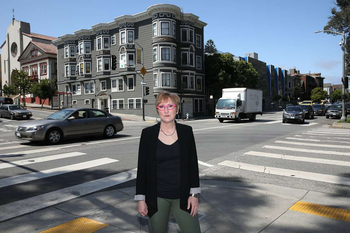 """Julie Nicholson poses for a portrait at the corner of Oak and Masonic in San Francisco, Calif., on Saturday, July 25, 2020. She was running at this location when she was hit by a car in January. """"I was celebrating the fact that my husband had just made it through his many months of chemo and that he was a cancer survivor and I was coming out doing my favorite form of self-care which is running,"""" Nicholson said. """"Somebody had run a red light, hit somebody else, making an illegal left turn, came into the panhandle where I was running and hit me and crashed into me. I was thrown thirty feet and that's the beginning of my survivors story."""" Nicholson shared she and her daughter are taking a vacation soon. """"This is a get away for me and my daughter. It's a time for me to go away to take some deep breaths, to celebrate the journey of coming here and the journey ahead,"""" Nicholson said. There's a lot of work to do to create safe streets here in San Francisco and across the Bay Area and across the nation. And I'm down to help in any way I can. So, I'm here to recharge, re-energize, and come back full steam."""""""