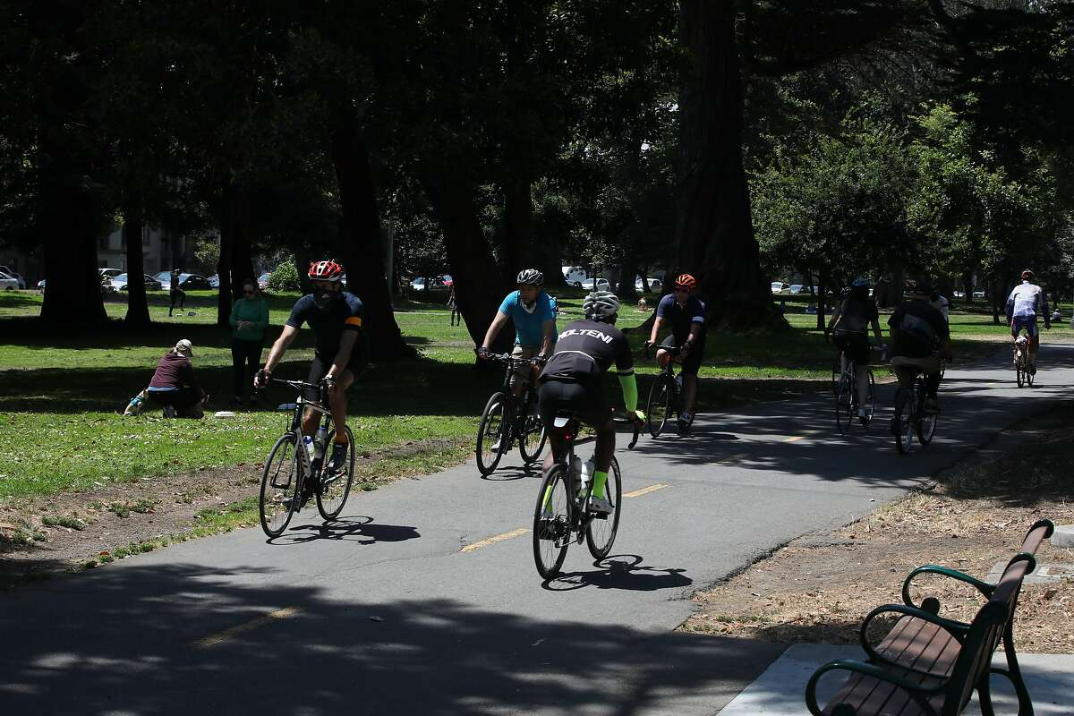 Cyclist ride on the bike lane at the Panhandle at Fell and Baker in San Francisco, Calif., on Saturday, July 25, 2020.