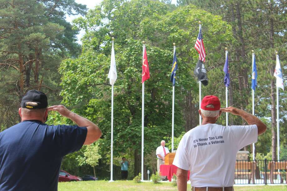 A new memorial honoring all branches of the military was unveiled Saturday at School Section Lake. The School Section Lake Veterans Park Memorial Project Committee originally broke ground on it in December. Photo: (Pioneer Photos/Catherine Sweeney)