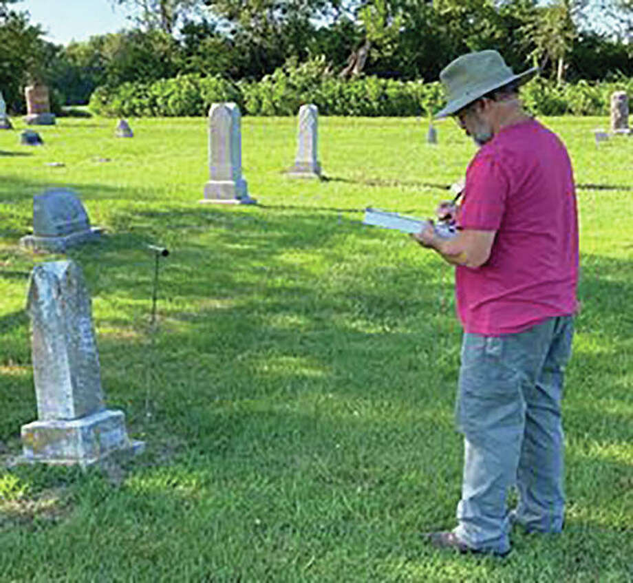 Dennis McGlasson transcribes a stone in East Newbern Cemetery in Dow. McGlasson and his wife, Beth, recorded cemeteries in Jersey County and currently are restoring East Newbern Cemetery. Photo: Photo Provided By Beth McGlasson|For The Telegraph