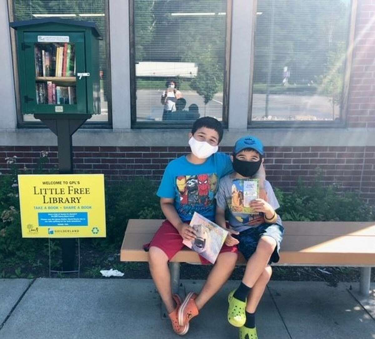 Henry and Oliver Rivas are avid readers and loyal Guilderland Public Library patrons, using the Little Free Library and curbside services extensively this summer. Their mother, Nareen, is the vice president of the library's Board of Trustees. (Courtesy Luanne Nicholson)