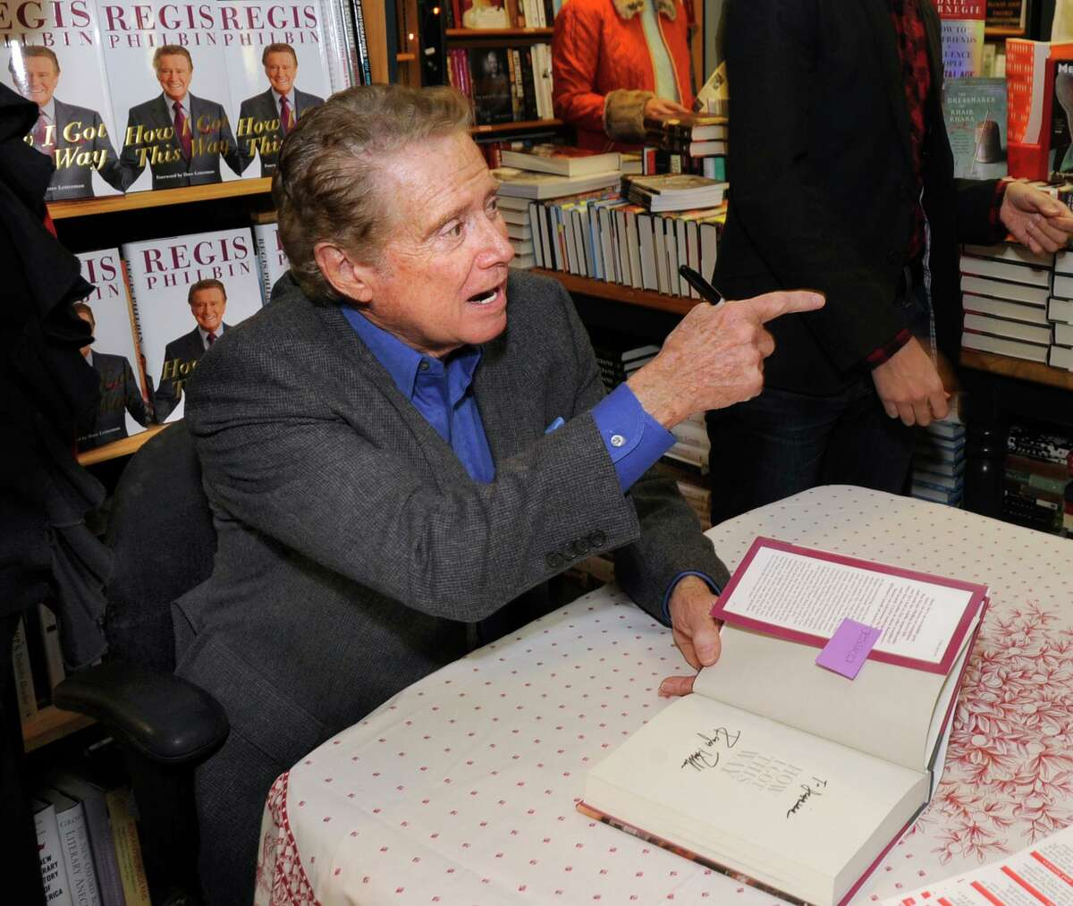 """Greenwich resident Regis Philbin signs a copy of his new memoir """"How I Got This Way,"""" during an appearance at Diane's Books in Greenwich, Saturday afternoon, Dec. 3, 2011."""