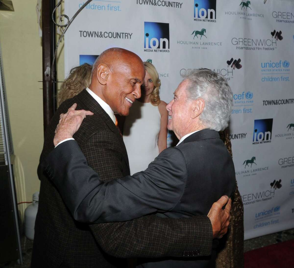 Regis Philbin, talk show host, greets honoree Harry Belafonte, left, during the Greenwich International Film Festival Gala honoring Belafonte for his philanthropic work with UNICEF at L'escale Restaurant & Bar in Greenwich, Conn., Saturday night, June 6, 2015.