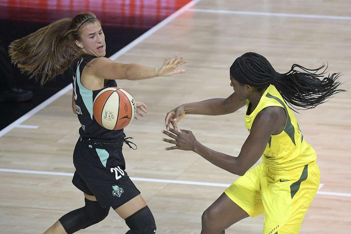 New York Liberty forward Sabrina Ionescu (left) slaps the ball away from the Seattle Storm's Crystal Langhorne during the second half of the WNBA season opener, the Miramonte-Orinda alum's WNBA debut, Saturday in Bradenton, Fla.
