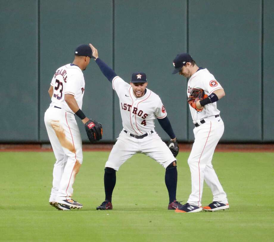 Houston Astros center fielder George Springer does a silly dance with Michael Brantley and Josh Reddick after the Astros beat the Seattle Mariners 7-2 during an MLB baseball game at Minute Maid Park, Saturday, July 25, 2020, in Houston. Photo: Karen Warren, Staff Photographer / © 2020 Houston Chronicle