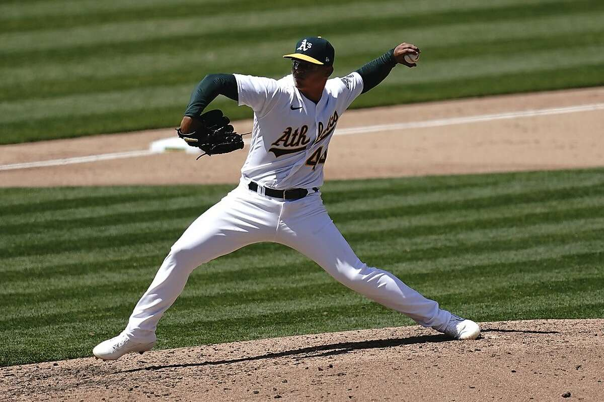 Oakland Athletics pitcher Jesus Luzardo throws against the Los Angeles Angels during the seventh inning of a baseball game in Oakland, Calif., Saturday, July 25, 2020. (AP Photo/Jeff Chiu)