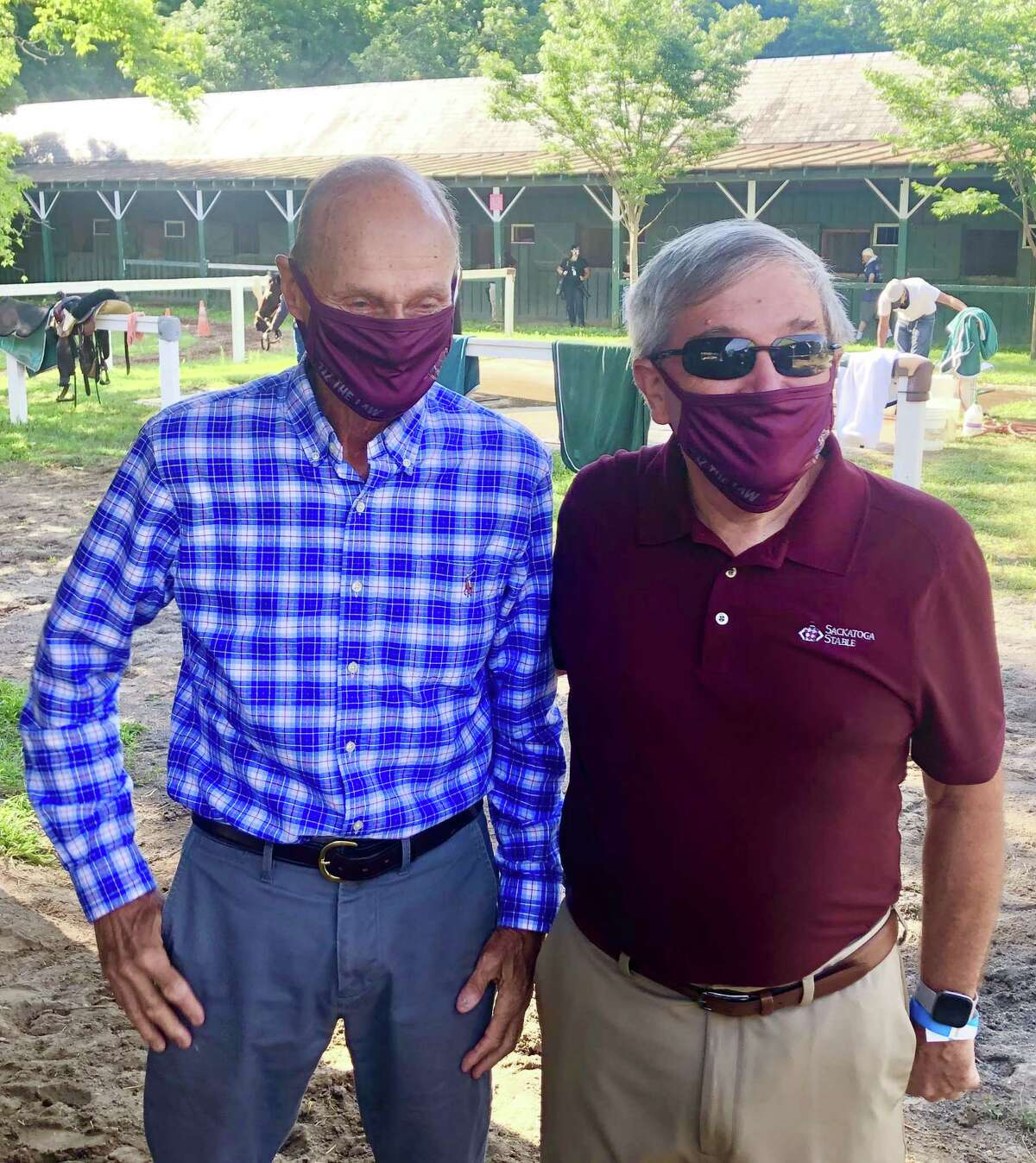 Everyone was in a good mood at trainer Barclay Tagg's barn on the Saratoga backstretch Saturday morning after stable star Tiz the Law breezed on the main track. That's Tagg on the left and Jack Knowlton, the operating manager of Sackatoga Stable, which owns Tiz the Law, on the right. Notice they are wearing their custom made Tiz the Law facemasks while posing for the paparazzi. They better have the masks on. It 'tiz the law' in these parts. (Tim Wilkin / Times Union)