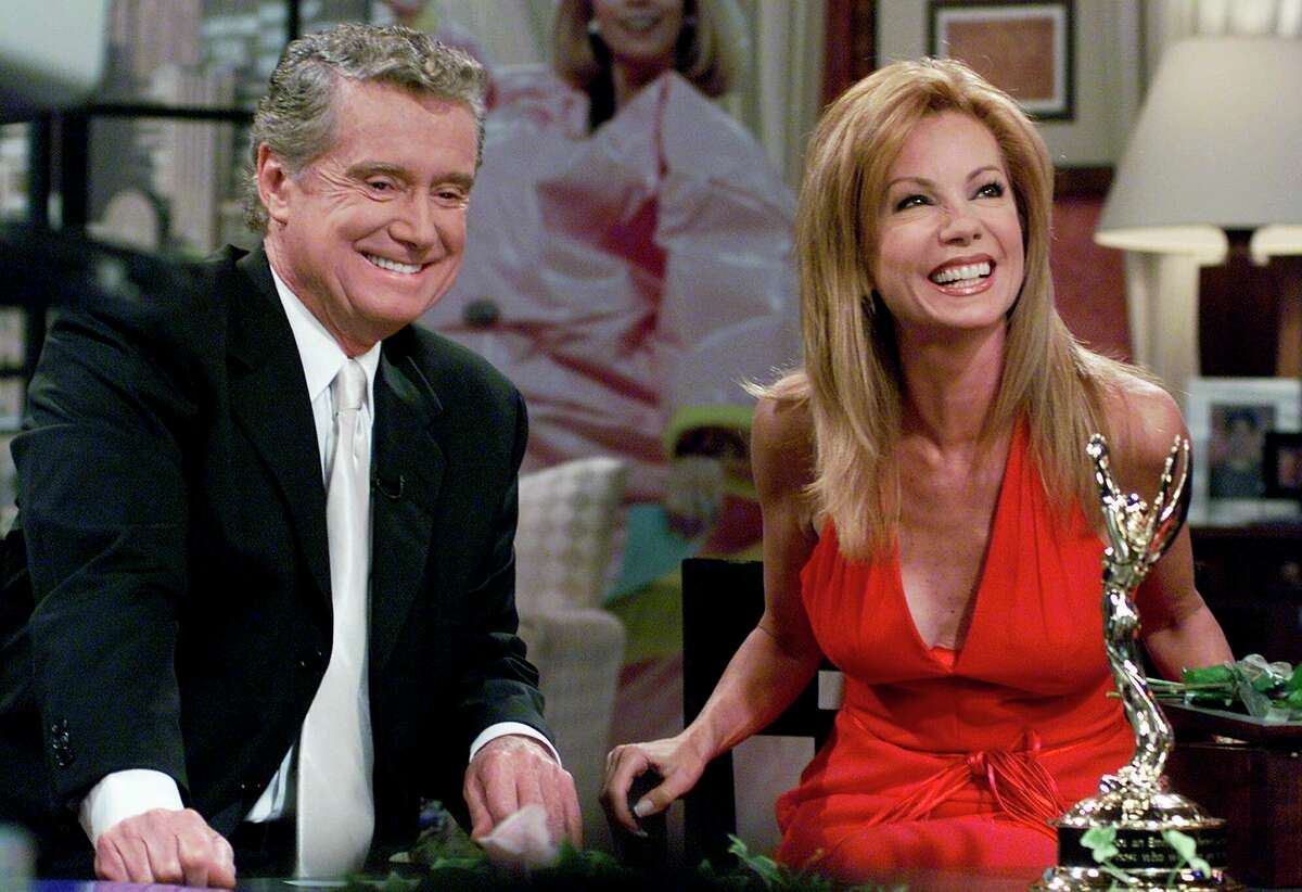 FILE - In this July 28, 2000 file photo, Kathie Lee Gifford and co-host Regis Philbin reminisce during her last appearance on the show, in New York. Philbin, the genial host who shared his life with television viewers over morning coffee for decades and helped himself and some fans strike it rich with the game show a€œWho Wants to Be a Millionaire,a€ has died on Friday, July 24, 2020. (AP Photo/Richard Drew)