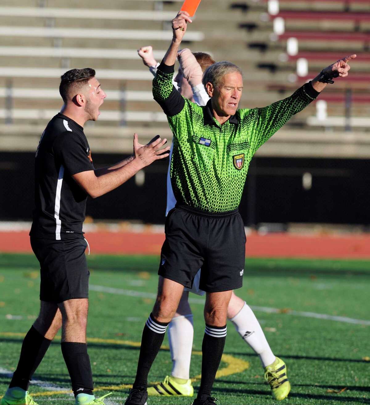 Shelton's Mikey Sciortino pleads with the referee after being called for interference and subsequently thrown out of the CIAC Class LL boys soccer final against Farmington at Memorial Stadium in New Britain in 2016.