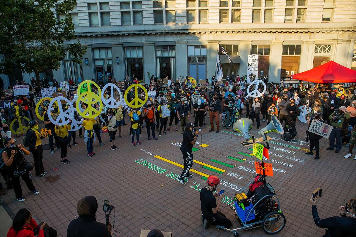 Protestors gather at Frank H. Ogawa Plaza in Oakland, CA on July 25, 2020 in support of the Black Lives Matter Movement.