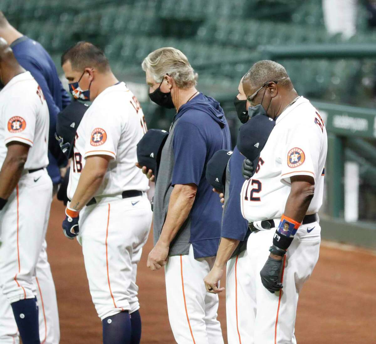 Houston Astros manager Dusty Baker during a moment of silence for Bob Watson and Jimmy Wynn before the start of the first inning of an MLB baseball game at Minute Maid Park, Saturday, July 25, 2020, in Houston.