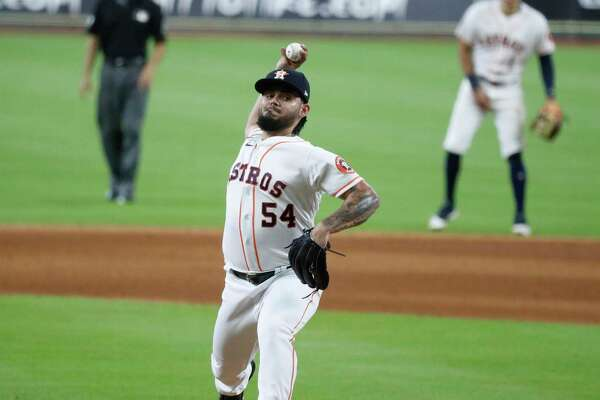 Houston Astros pitcher Roberto Osuna pitches during the ninth inning of an MLB baseball game at Minute Maid Park, Saturday, July 25, 2020, in Houston.