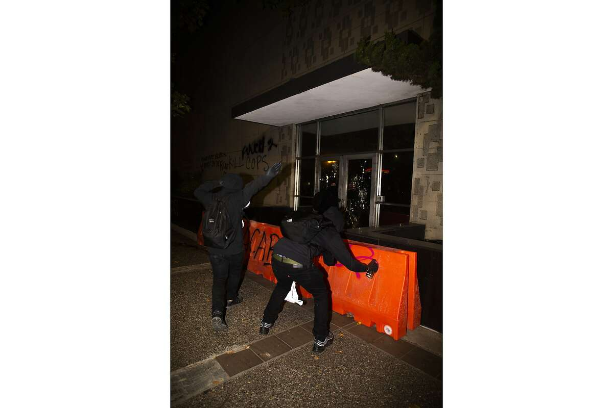 Protesters vandalize the Oakland Police Department on July 25, 2020 in Oakland, CA.