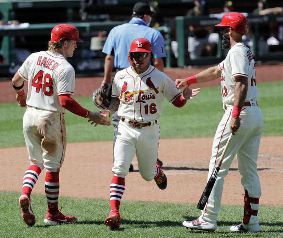 The Cardinals' Harrison Bader (48) and Kolten Wong (16) are congratulated by teammate Matt Carpenter after both scored runs in the seventh inning against the Pittsburgh Pirates on Saturday at Busch Stadium. Photo: Associated Press