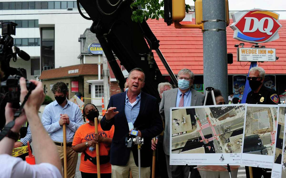 Jim Travers. Bureau Chief for the City of Stamford Transportation, Traffic and Parking, announces with Mayor David Martin a $1.4 million pedestrian safety project along Summer Street in downtown Stamford, Connecticut on July 23, 2020. The improvements at the Summer Street intersections at Main Street, Broad Street, North Street and Hoyt Street, sites of several accidents involving pedestrians including a fatal, will take until the end of the year to complete. A bump out the curb line to give more room to pedestrians on those 12 corners, while installing high visibility thermo plastic crosswalk treatment and lighted signs will also be put in place to let drivers know when to yield to pedestrians.