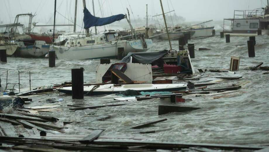 Loose and damaged boats are tossed around after the docks at the marina where they had been secured were destroyed as Hurricane Hanna made landfall, Saturday, July 25, 2020, in Corpus Christi, Texas. (AP Photo/Eric Gay) Photo: Eric Gay, STF / Associated Press / Copyright 2020 The Associated Press. All rights reserved.