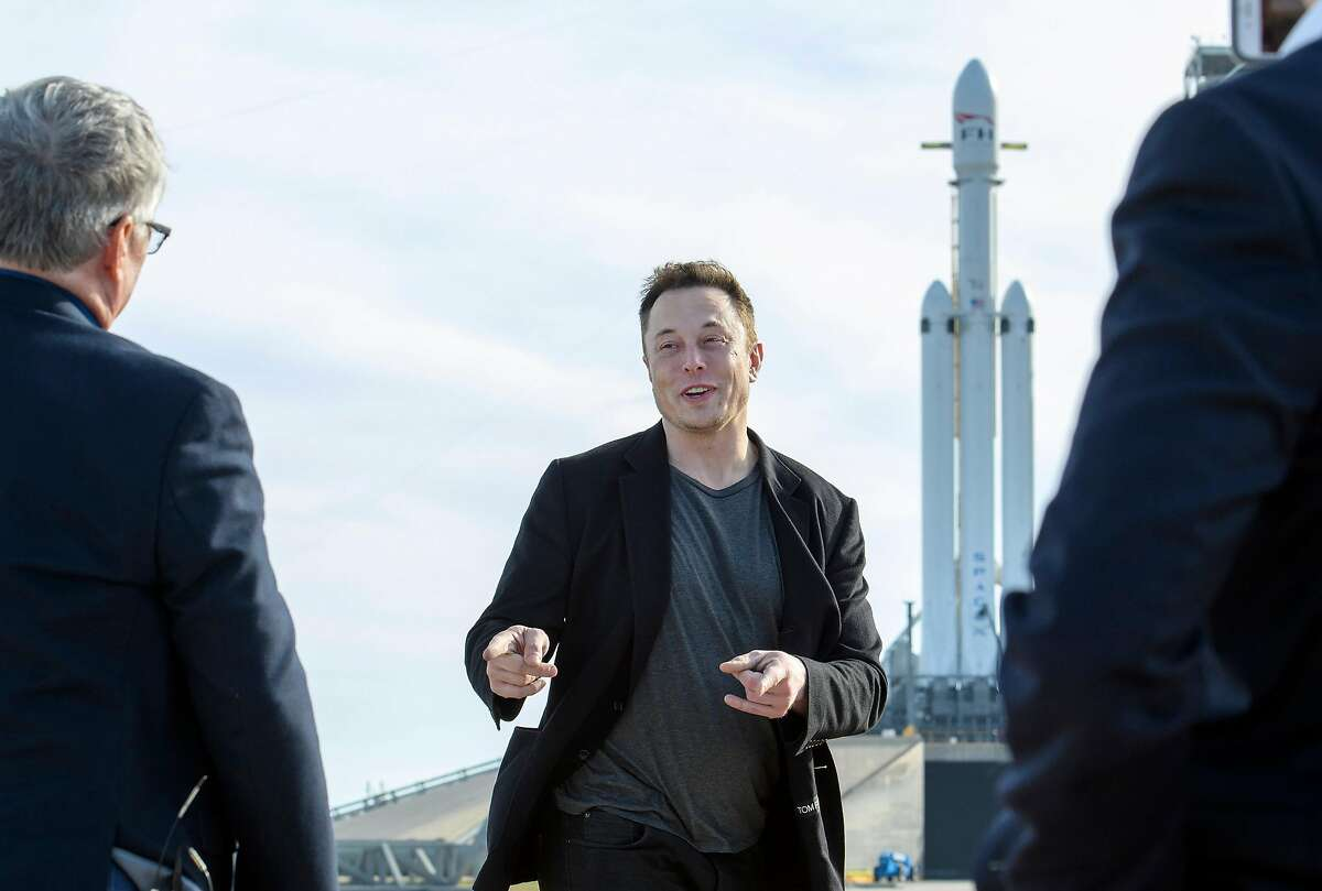 Elon Musk, founder of SpaceX, speaks to reporters, with the company's Falcon Heavy rocket standing by at Launch Pad 39A at NASA's Kennedy Space Center in Cape Canaveral, Fla., Feb. 5, 2018. The billionaire space oddity on life with Grimes and Baby X, Trump, Tesla, tunnels, short shorts, stock surges, Facebook fumbles and everything else under the sun. (Todd Anderson/The New York Times)