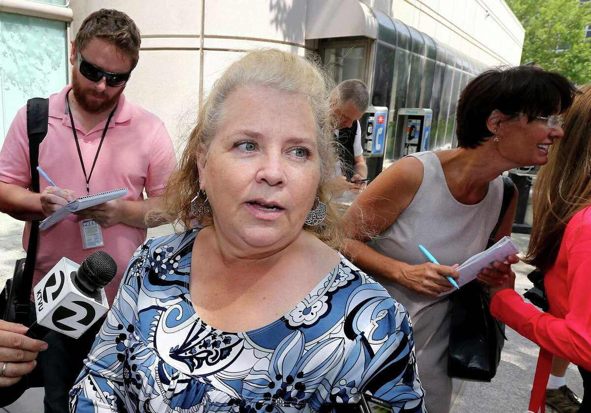 FILE - In this Aug. 23, 2018, file photo Jennifer Carole, the daughter of Lyman Smith, believed to be one of the victims of the Golden State Killer, talks with reporters after Joseph James DeAngelo's court appearance in Sacramento, Calif. Forty years after a sadistic suburban rapist terrorized California in what investigators only later realized were a series of linked assaults and slayings, the 74-year-old former police officer is tentatively set to plead guilty Monday, June 29,2020, to being the elusive Golden State Killer.
