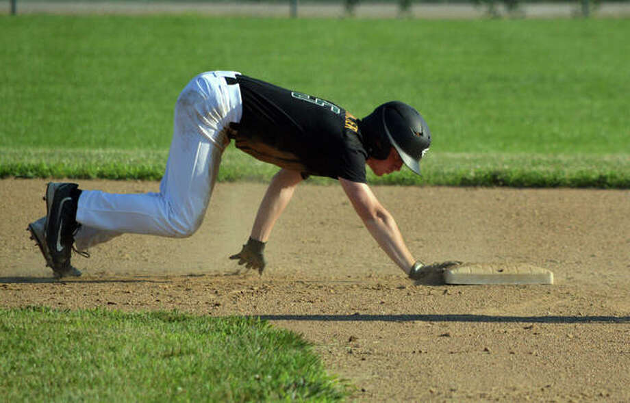 Metro-East Lutheran's Brendan Steinmeyer dives back to second base during the second inning of Friday's summer league game at MELHS. Photo: Scott Marion/The Intelligencer
