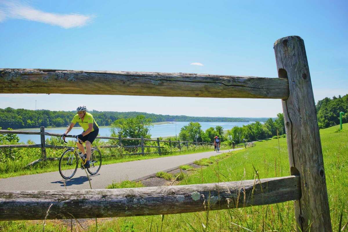 Bicyclists peddle their way up a hill on a bike path along the Mohawk River on Sunday, July 26, 2020, in Niskayuna, N.Y. (Paul Buckowski/Times Union)