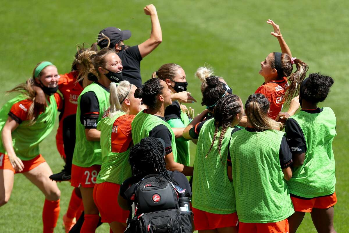 Shea Groom #6 of Houston Dash celebrates with her teammates after scoring a goal in the 91st minute against Alyssa Naeher #1 of Chicago Red Stars during the second half in the championship game of the NWSL Challenge Cup at Rio Tinto Stadium on July 26, 2020 in Sandy, Utah. (Photo by Maddie Meyer/Getty Images)