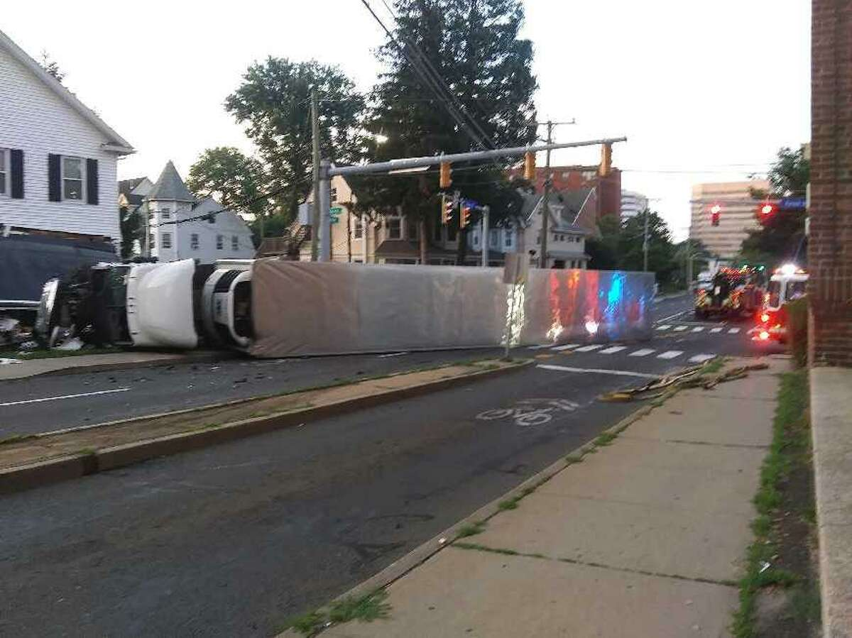 An 18-wheeler crashed into a downtown Stamford home after colliding with a red-light runner at the corner of Grove and Forest streets early Sunday morning, police said.