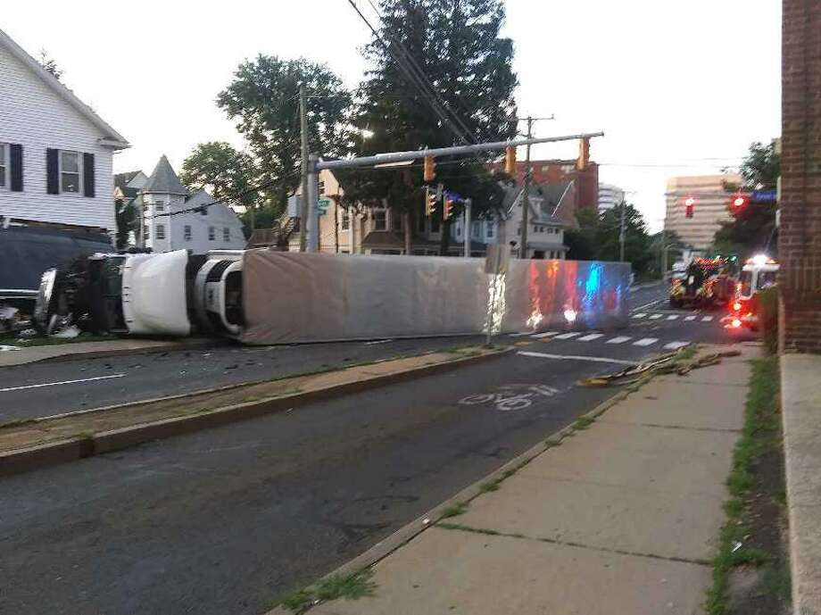 An 18-wheeler crashed into a downtown Stamford home after colliding with a red-light runner at the corner of Grove and Forest streets early Sunday morning, police said. Photo: / Contributed