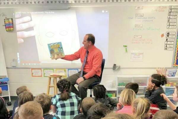 Josh Bull reads to fourth-graders at Riverview Elementary School during March is Reading Month. He was a guest speaker during the month-long reading event, which celebrates Dr. Suess' birthday. (Courtesy photo)