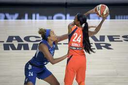 Minnesota Lynx forward Napheesa Collier, left, defends against Connecticut Sun forward DeWanna Bonner during the first half Sunday.