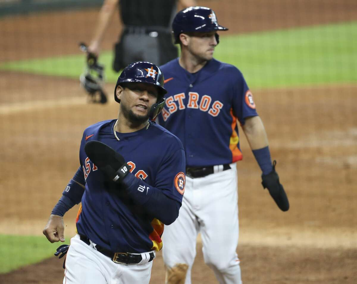 Houston Astros first baseman Yuli Gurriel (10) and third baseman Alex Bregman (2) score during the bottom fourth inning of a MLB game against the Seattle Mariners with a single by Martin Maldonado Sunday, July 26, 2020, at Minute Maid Park in Houston. The Houston Astros leads the Seattle Mariners 5-4.
