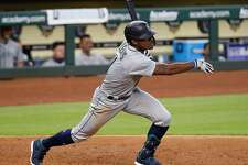 HOUSTON, TEXAS - JULY 26: Kyle Lewis #1 of the Seattle Mariners singles in two runs in the eighth inning against the Houston Astros at Minute Maid Park on July 26, 2020 in Houston, Texas. (Photo by Bob Levey/Getty Images)