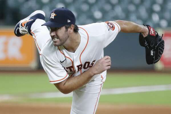 Houston Astros pitcher Justin Verlander pitches during the fifth inning of an MLB Opening Day at Minute Maid Park, Friday, July 24, 2020, in Houston.