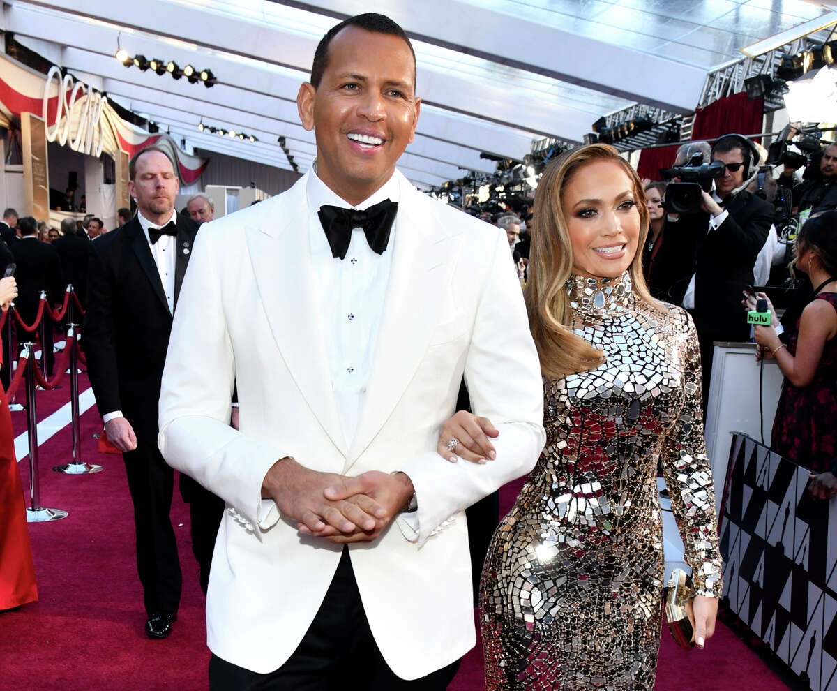 FILE - In this Sunday, Feb. 24, 2019, file photo, Alex Rodriguez, left, and Jennifer Lopez arrive at the Oscars at the Dolby Theatre in Los Angeles. Rodriguez and Lopez are engaged. The couple posted an Instagram photo of their hands with a massive engagement ring on Lopeza€™s ring finger. (Photo by Charles Sykes/Invision/AP, File)