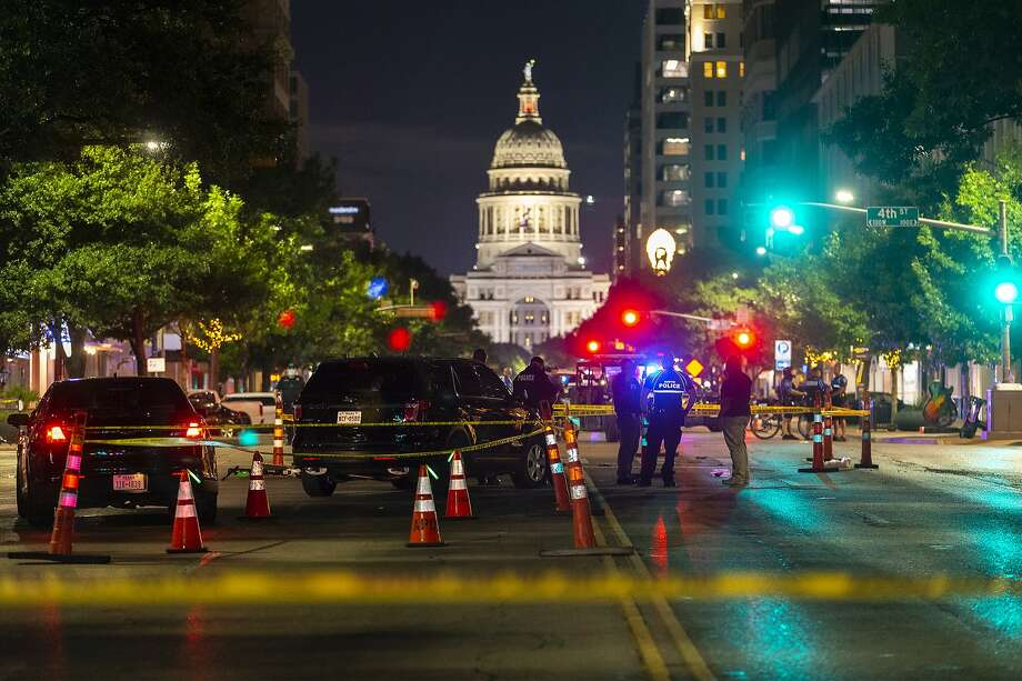 Austin police investigate a homicide shooting which occurred at a demonstration against police violence in downtown Austin, Saturday, July 25, 2020. (Stephen Spillman/Austin American-Statesman via AP) Photo: Stephen Spillman, Associated Press