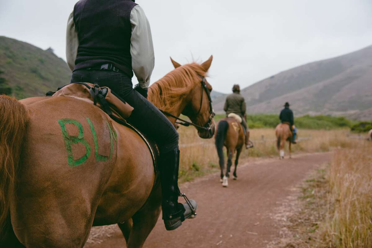 Protestors on horseback ride on Rodeo Valley Trail in Sausalitoduring the Heels Down Fists Up protest in solidarity with the Black Lives Matter movement on July 26, 2020.
