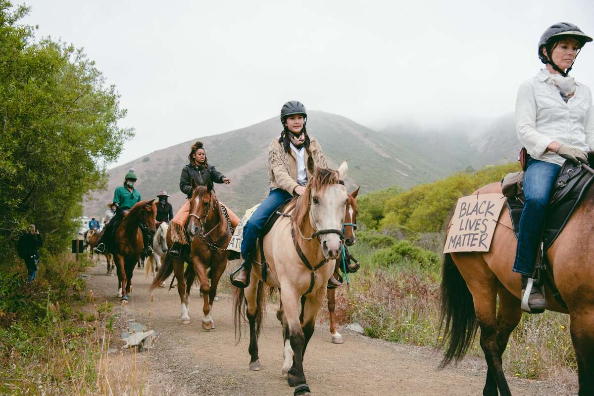 Protestors on horseback ride on Rodeo Valley Trail in Sausalito during the Heels Down Fists Up protest in solidarity with the Black Lives Matter movement on July 26, 2020.