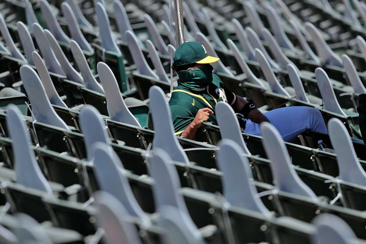 Frankin Barreto (4) sits in the auxiliary team seating with the cutouts as the Oakland Athletics played the Los Angeles Angels of Anaheim at the Coliseum in Oakland, Calif., on Sunday, July 26, 2020.