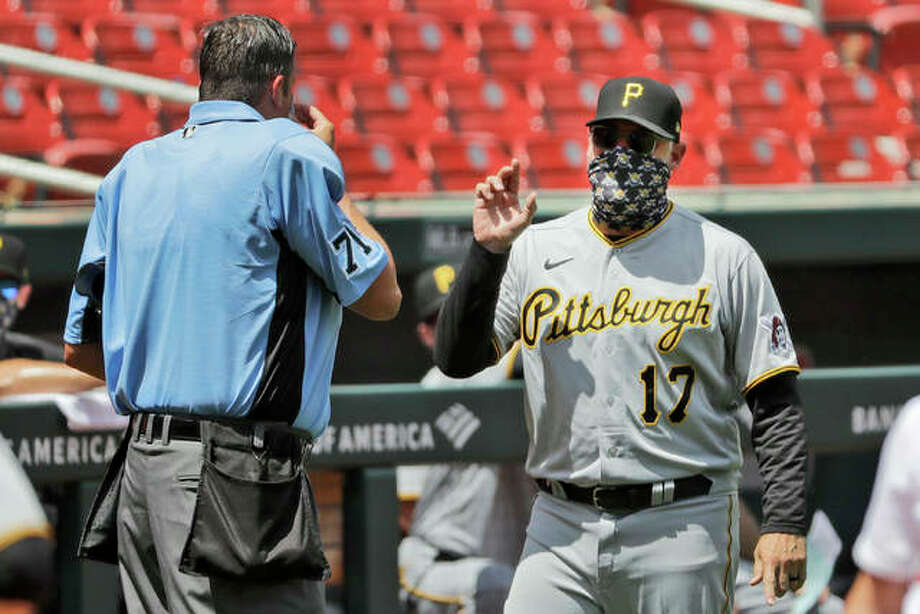 Pirates manager Derek Shelton (17) argues with plate umpire Jordan Baker during the third inning against the Cardinals on Sunday at Busch Stadium. Photo: Associated Press