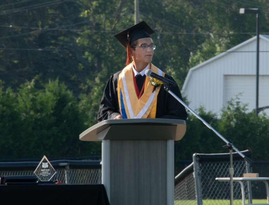 Ubly High School seniors graduate July 26 on the football field. A sunny day showered family, friends, and community members as they watched the local graduates accept their diploma's on a long anticipated day. Photo: Aurora Abraham/Huron Daily Tribune