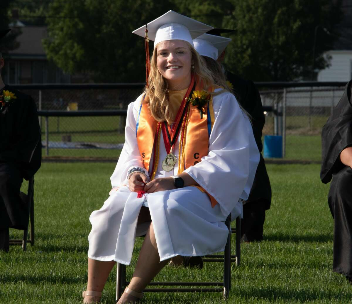 Ubly High School seniors graduate July 26 on the football field. A sunny day showered family, friends, and community members as they watched the local graduates accept their diploma's on a long anticipated day.