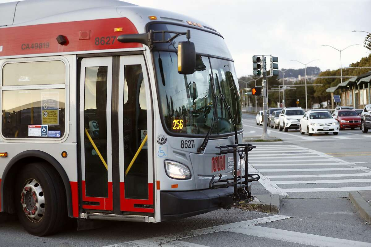 A MUNI bus turns onto 19th Avenue from Stonestown Galleria in San Francisco, Calif., on Thursday, April 9, 2020.