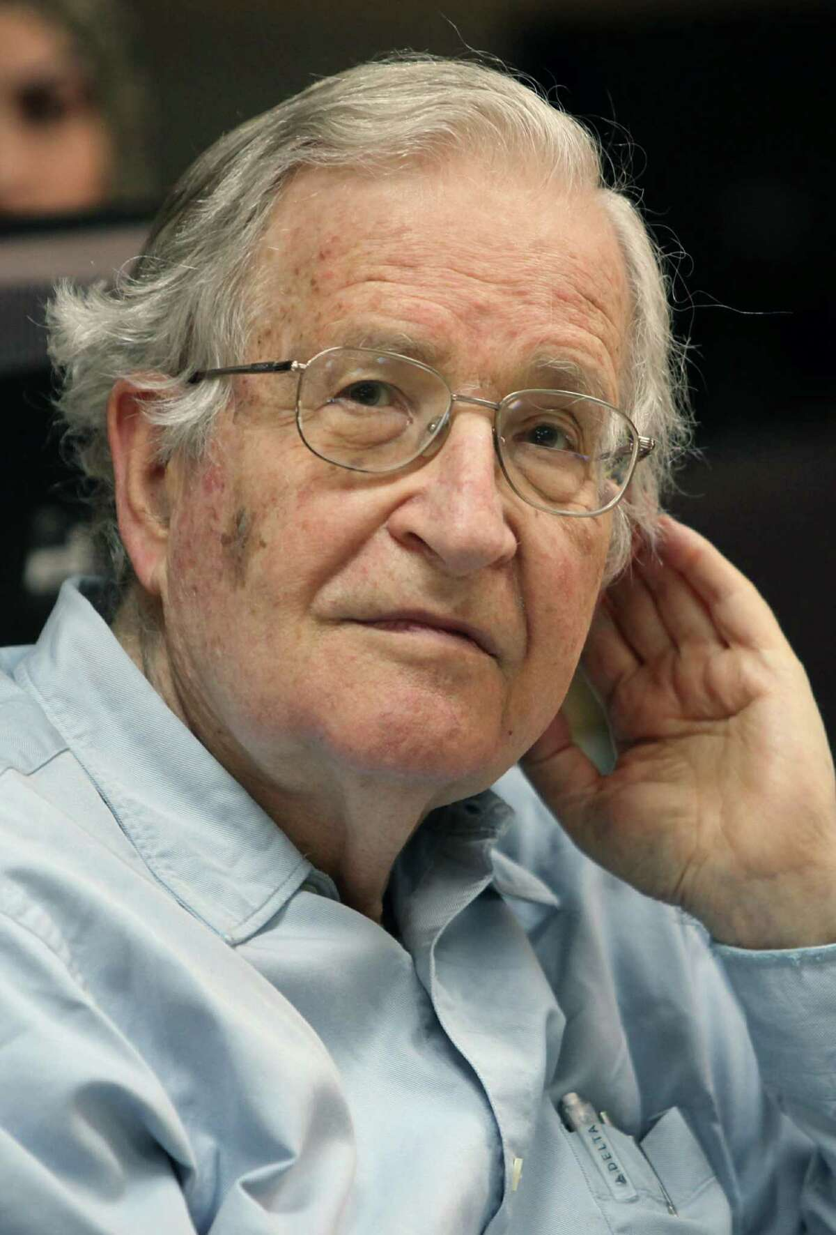 Renowned Jewish-American scholar and political activist Noam Chomsky waits to speak during a scheduled lecture at Bir Zeit University by video conference from Jordan University in Amman after he was officially barred from entering Israel and the West Bank, on May, 18, 2010. Chomsky had been invited to speak at Bir Zeit University today near the Palestinian West Bank city of Ramallah, but was stopped from entering the West Bank at the Israeli-controlled crossing from Jordan. Chomsky, 81, is a professor of linguistics at the US Massachusetts Institute of Technology and a prominent critic of US foreign policy. He has also frequently spoken out against Israel's occupation of Palestinian territories. AFP PHOTO/KHALIL MAZRAAWI (Photo credit should read KHALIL MAZRAAWI/AFP/Getty Images)(Photo Credit should Read /AFP/Getty Images)