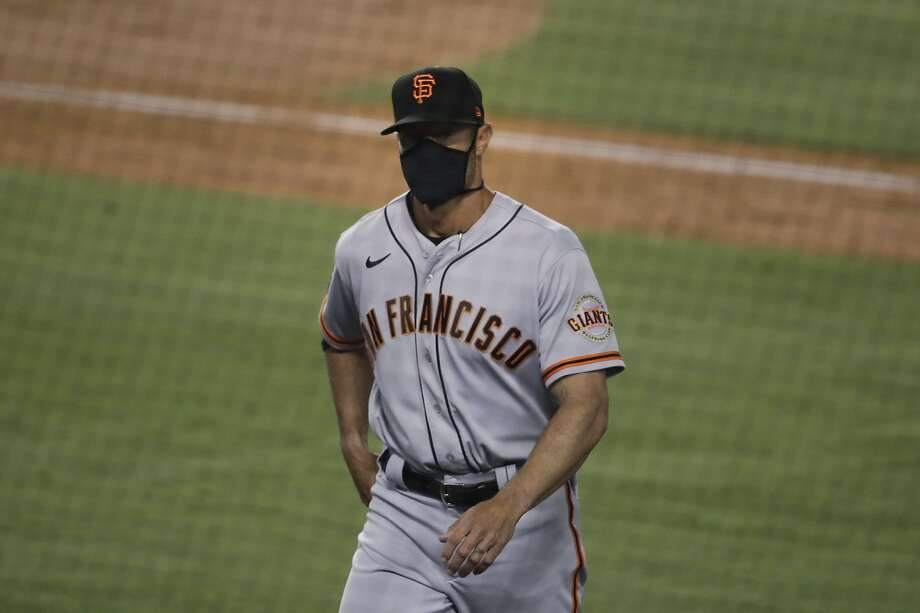 San Francisco Giants manager Gabe Kapler walks toward the dugout after visiting the mound during the fifth inning of a baseball game against the Los Angeles Dodgers, Sunday, July 26, 2020, in Los Angeles. (AP Photo/Jae C. Hong) Photo: Jae C. Hong, Associated Press
