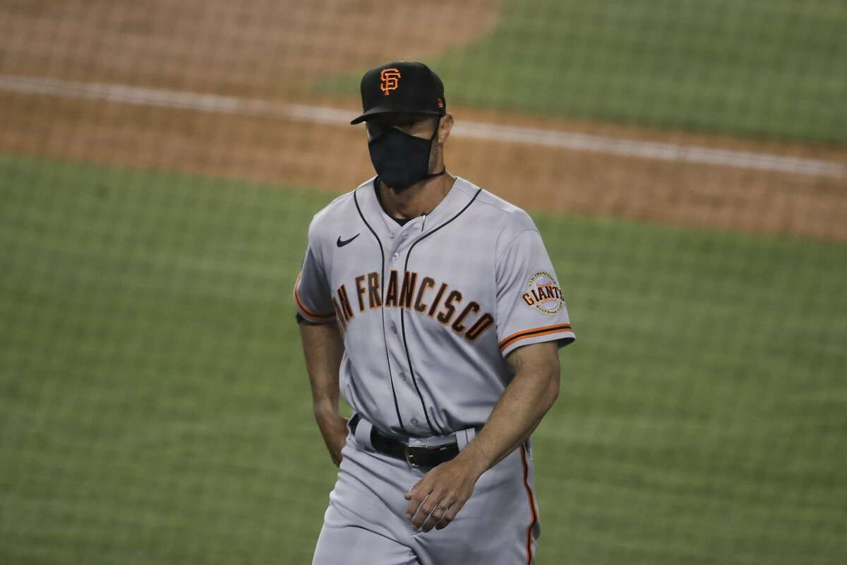 San Francisco Giants manager Gabe Kapler walks toward the dugout after visiting the mound during the fifth inning of a baseball game against the Los Angeles Dodgers, Sunday, July 26, 2020, in Los Angeles. (AP Photo/Jae C. Hong)