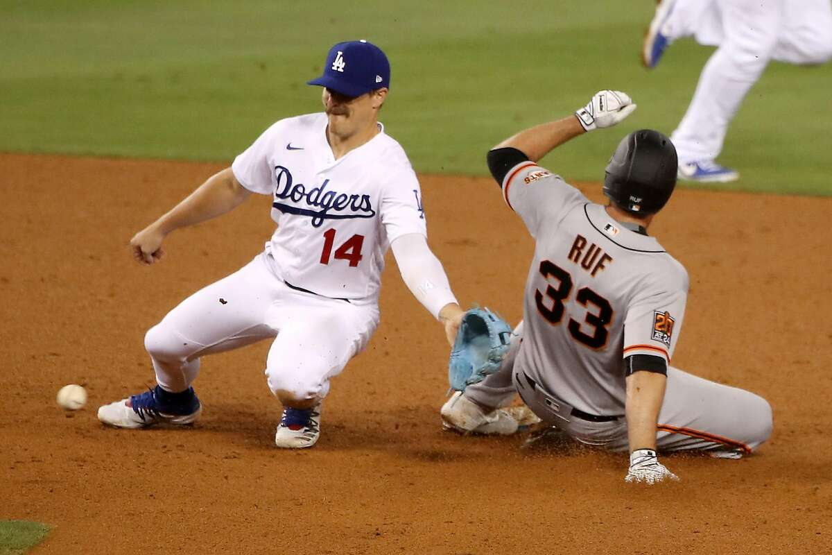 LOS ANGELES, CALIFORNIA - JULY 26: Darin Ruf #33 of the San Francisco Giants steals second base from Enrique Hernandez #14 of the Los Angeles Dodgers during the seventh inning at Dodger Stadium on July 26, 2020 in Los Angeles, California. (Photo by Katelyn Mulcahy/Getty Images)