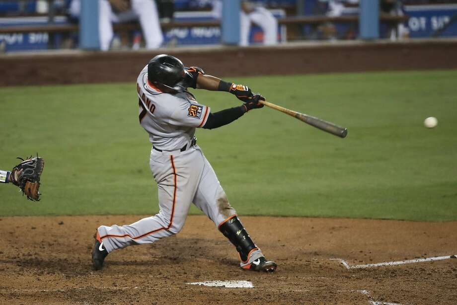San Francisco Giants' Donovan Solano connects with an RBI single during the seventh inning of the team's baseball game against the Los Angeles Dodgers, Sunday, July 26, 2020, in Los Angeles. (AP Photo/Jae C. Hong) Photo: Jae C. Hong, Associated Press